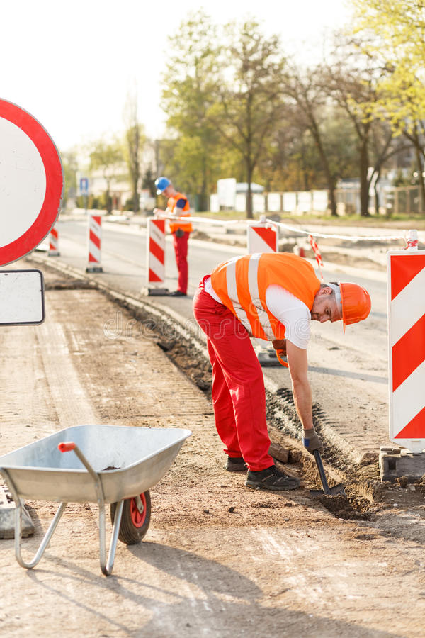 Blue collar worker labouring hard royalty free stock image