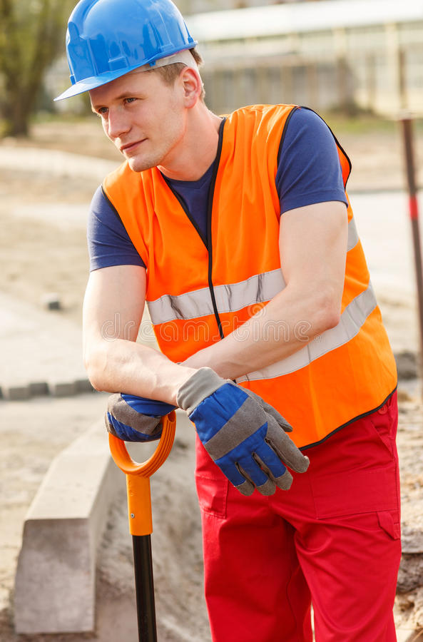 Blue collar worker standing stock photography