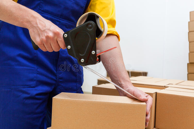 Blue collar worker with tape gun royalty free stock photos
