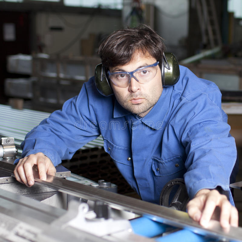 Blue-collar Working In Fabric Royalty Free Stock Image
