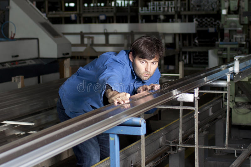 Blue-collar working in fabric royalty free stock photography