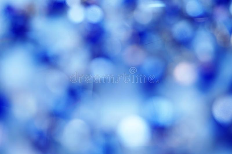 Blue abstract background with blurred defocus bokeh light. Blue color abstract background with blurred defocus bokeh light royalty free stock image