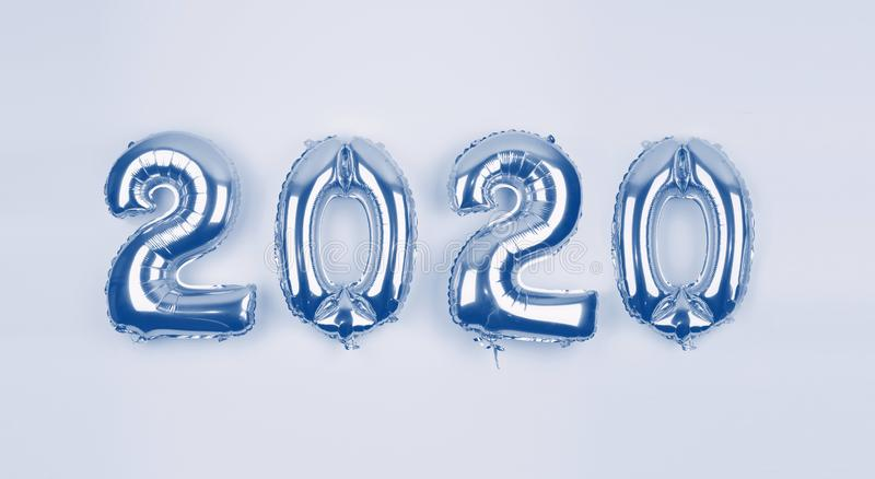 Blue Color background with foil balloon figures 2020. Happy New Year 2020 festive background stock images