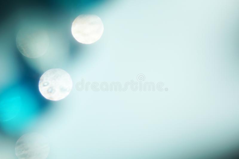 Blue color blurred background. Bright blue and white abstract background with blurred lights bokeh glowing christmas artwork backdrop beautiful blink brilliance stock photos