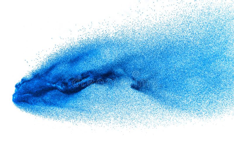 Blue color dust particles splash on white background. Abstract blue powder particle explosion royalty free stock photo