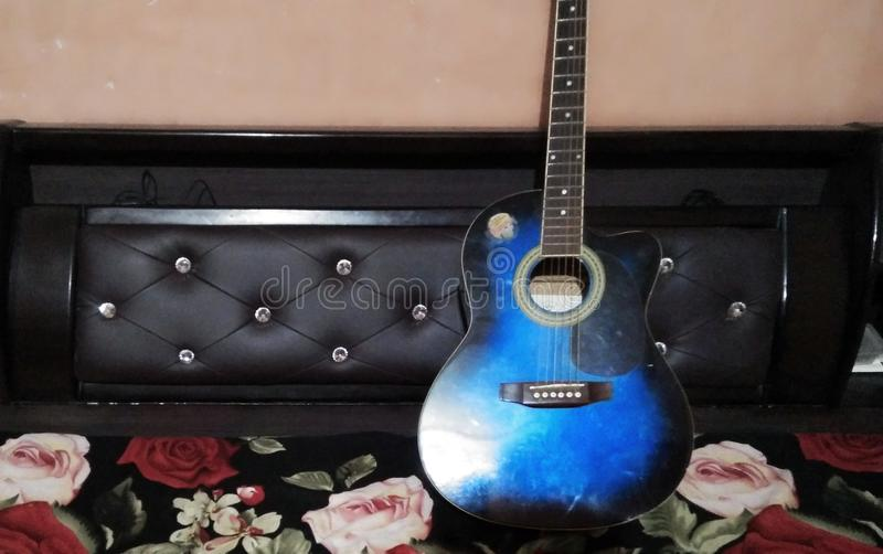 The Blue Color Guitar royalty free stock photography