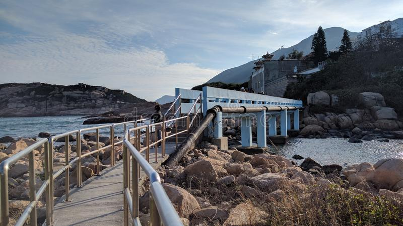 Blue color Lovely Bridge in Shek O beach royalty free stock image