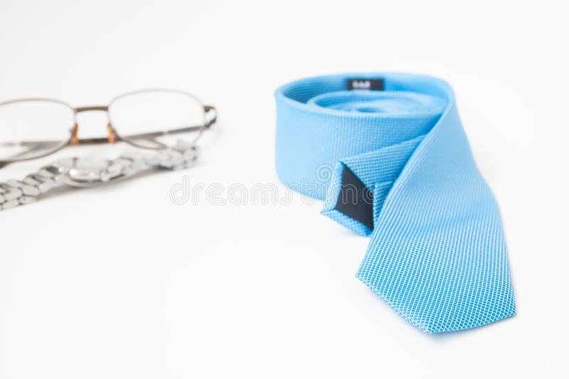 Blue color necktie, watch and eyewear on white background, Man a stock photography