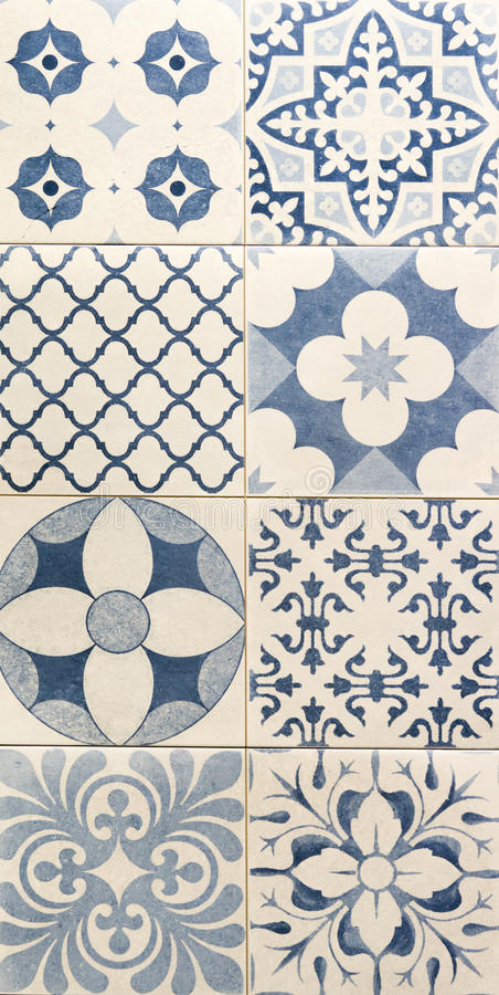 Blue color pattern on white mosaic tiles stock image