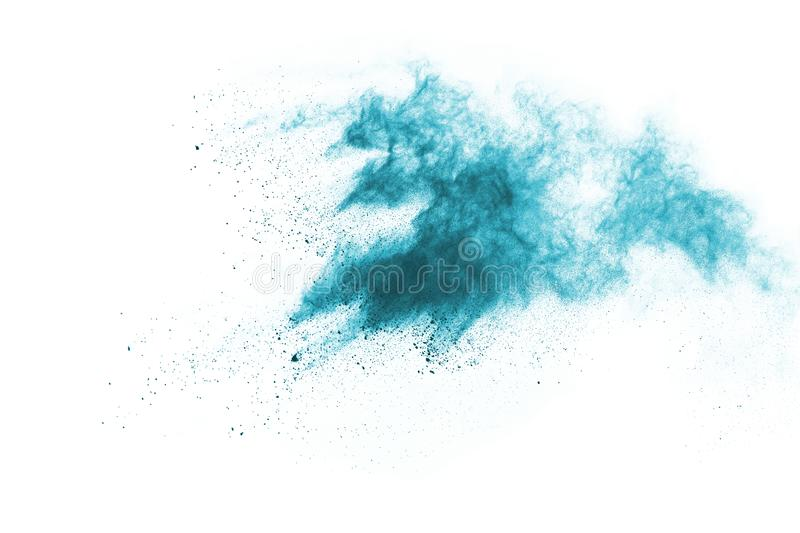 Blue color powder explosion on white background. royalty free stock image