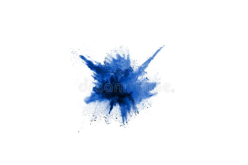 Blue color powder explosion on white background. royalty free stock photos