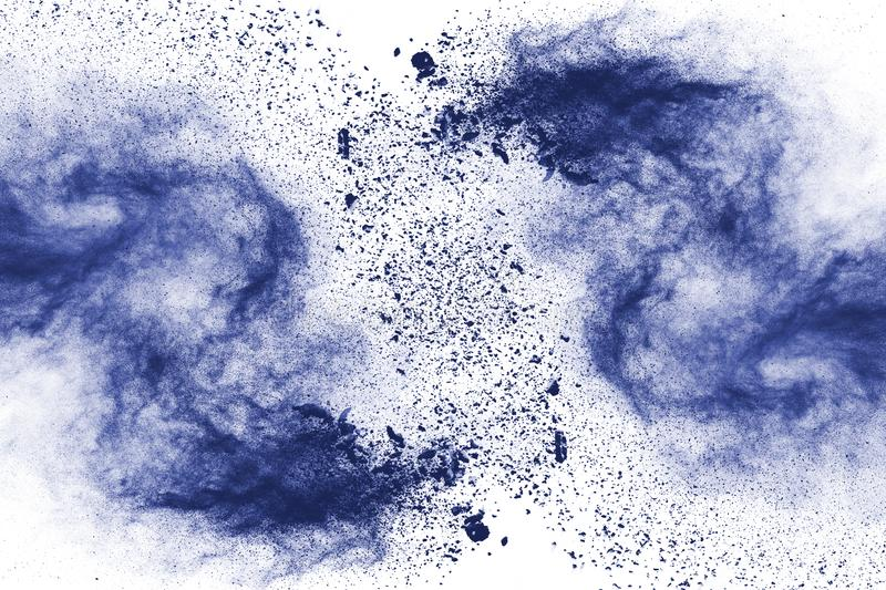 Blue color powder explosion on white background. stock photo