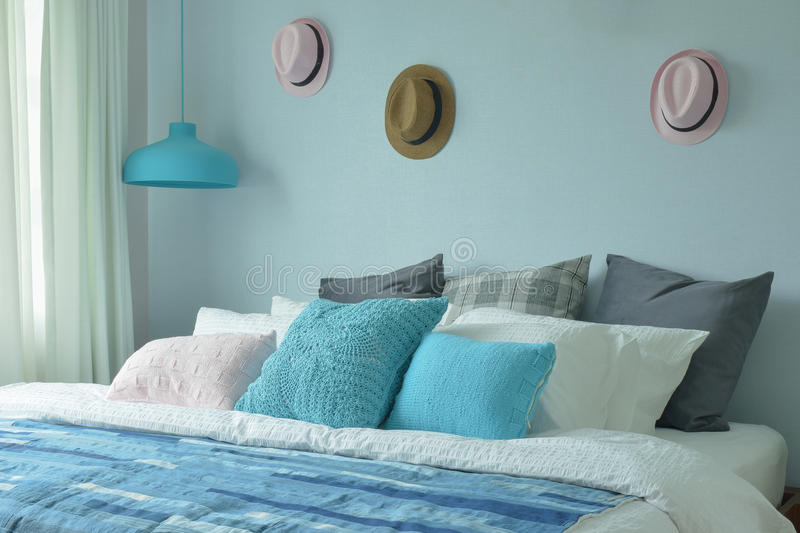 Blue color scheme teenager bedroom with hats on wall. Decoration stock photography