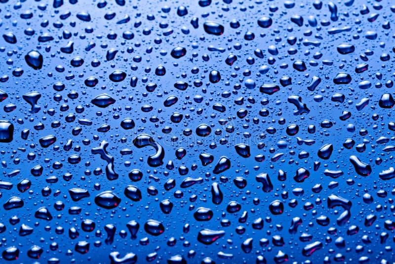Blue color water drops background. Blue color water drops background royalty free stock photo