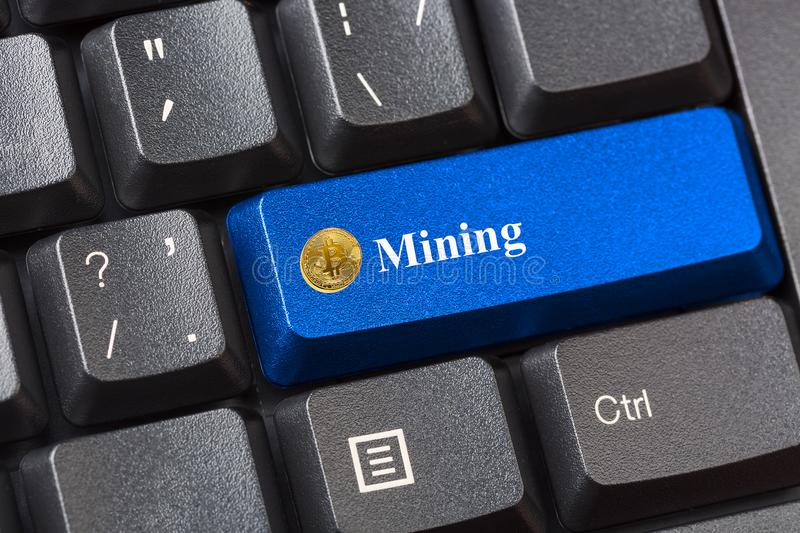 Blue colored Bitcoin Mining button on black computer keyboard. Crypto currency Internet data privacy information security concept. stock photos