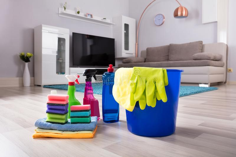 House Cleaning Products On Hardwood Floor royalty free stock photography