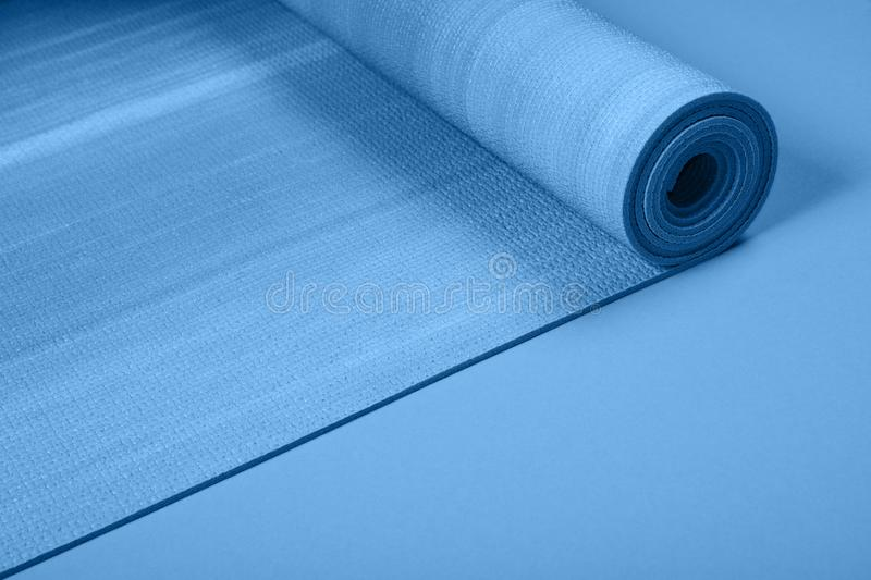 Blue colored exercise mat on background with copy space stock image