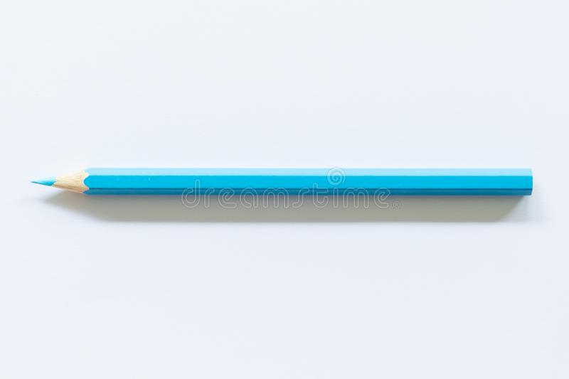 Blue colored pencil  One single object, top view, bright tint. Blue colored pencil One single object, top view, bright tint royalty free stock photos
