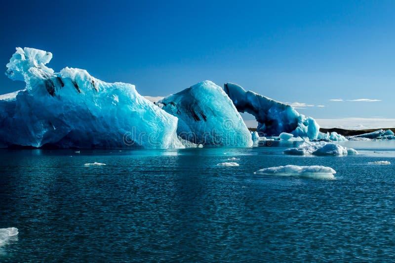 Blue coloured icebergs in glacier lagoon. Beautiful blue coloured icebergs in the Jokulsarlon Glacier Lake, Iceland stock photos