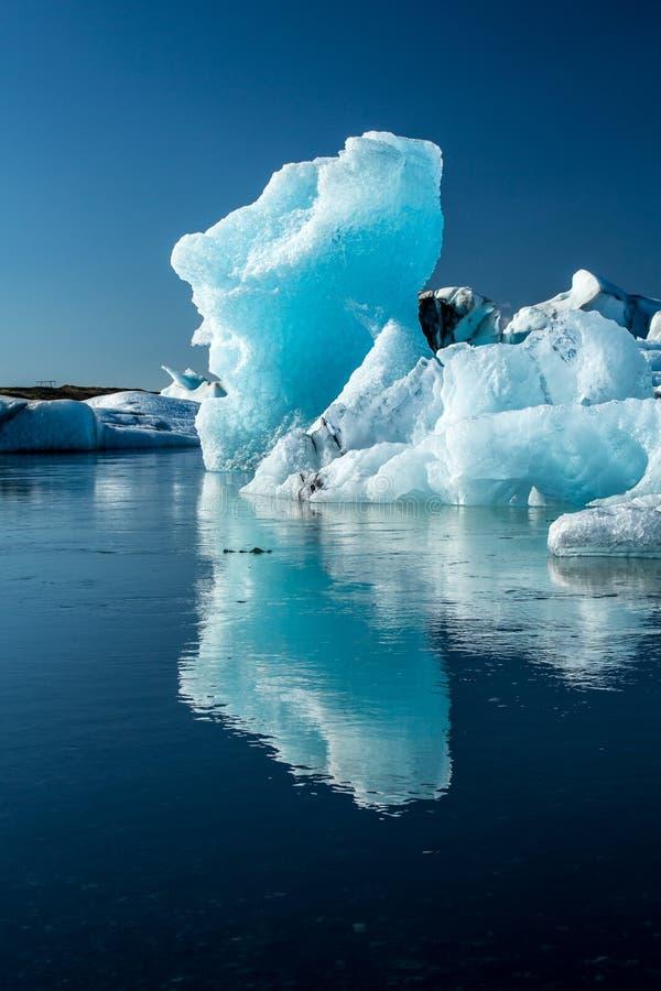 Blue coloured icebergs in Glacier Lagoon. Beautiful blue coloured icebergs with reflection in the Jökulsárlón Glacier Lake, Iceland stock photo