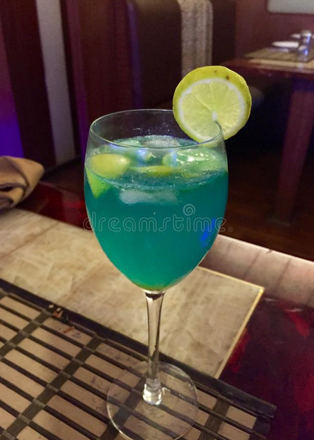 A blue coloured mocktail with lemon royalty free stock photos