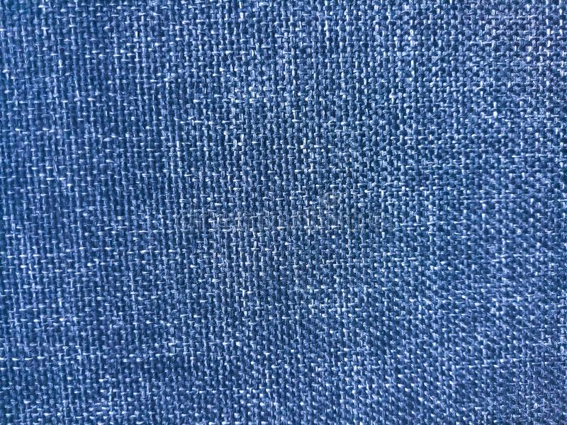 Blue coloured thick cloth material texture background,close up shot. Blue coloured thick cloth material textured background,close up shot, useful for web,banner royalty free stock image