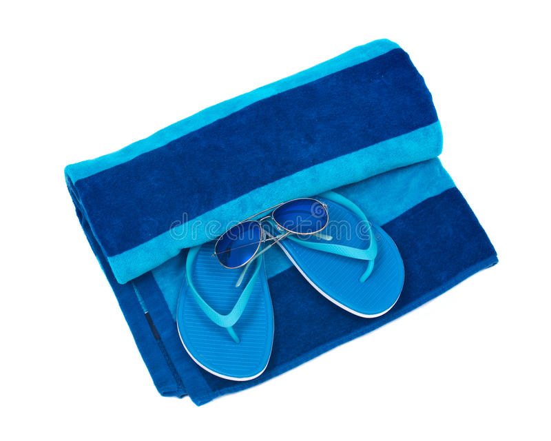 Blue cotton beach towel, flip flops and sunglasses. Isolated on white background royalty free stock photography
