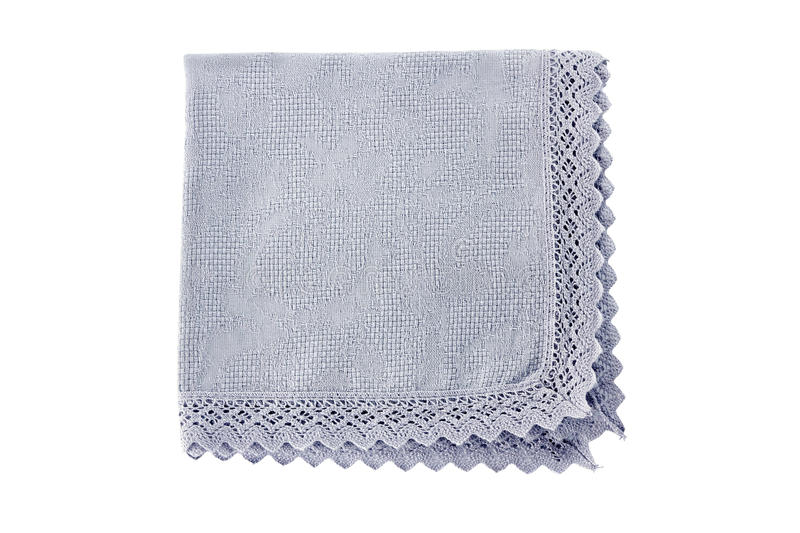Blue cotton napkin on white. Blue cotton napkin with crocheted border isolated on white background stock images