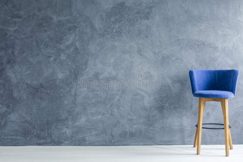 Blue counter stool. Interior with blue counter stool and grey wall royalty free stock image
