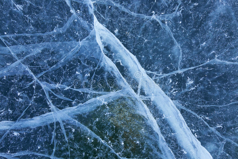 Blue Cracked Ice Background. A cracked and marred blue ice background texture royalty free stock photography