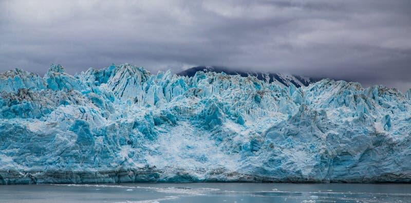 Blue Craggy Ice of Hubbard Glacier. Hubbard Glacier in Alaska under Cloudy Skies stock images
