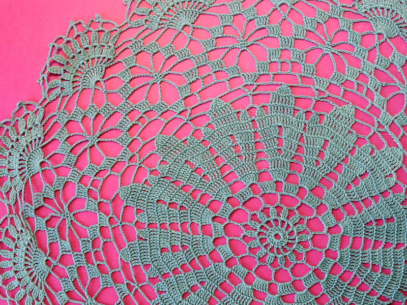 Blue crochet serviette. On pink background royalty free stock photos