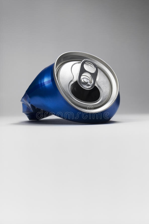Blue crushed soda can royalty free stock image