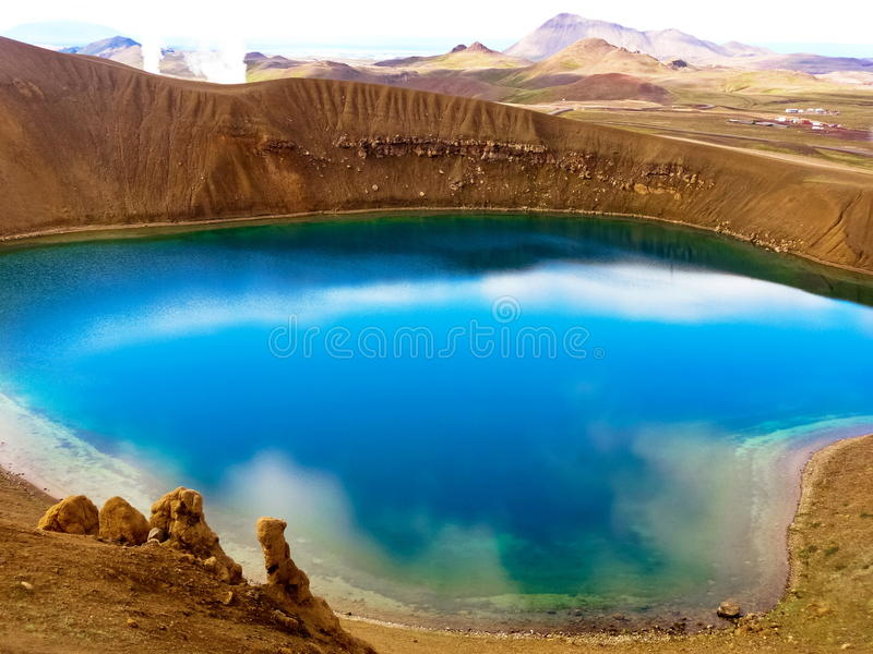 Blue crystal lake. With clouds reflected inside stock photography