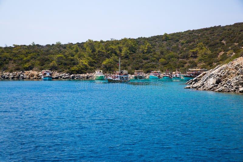 Bay with crystal blue water of Mideterranean sea Aegean Turkey, Bodrum royalty free stock image