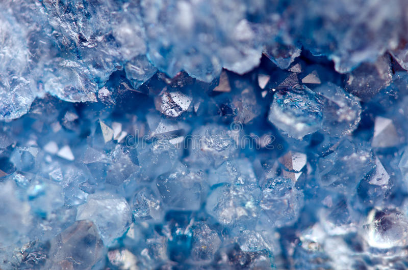 Blue crystals Agate SiO2. Macro royalty free stock photos