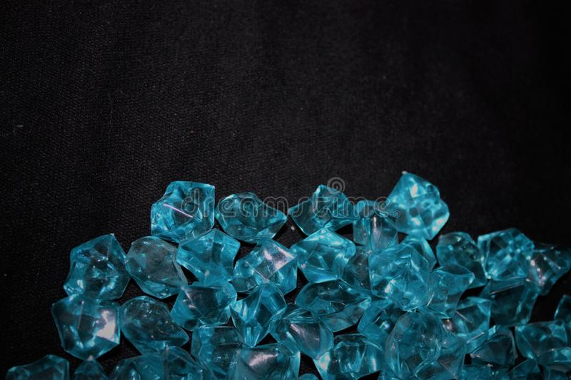 Blue crystals on a black background stock images