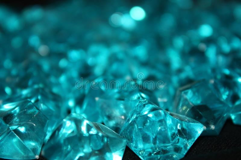 Blue crystals on a black background stock photos
