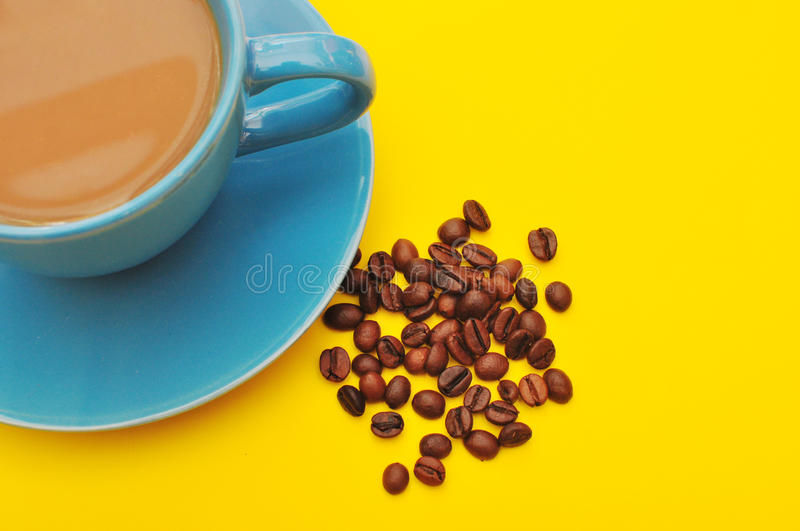 Blue cup of coffee with coffee grain royalty free stock photography
