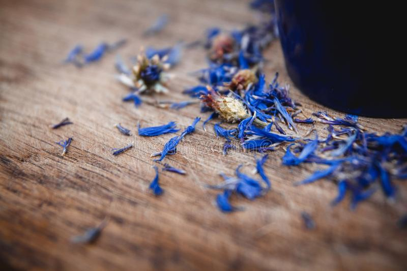 Blue cup with flowered tea on a wooden background. Breakfast, health, herbal therapy, healthy food. Concept and royalty free stock image