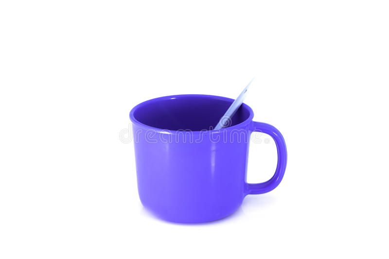 Blue Cup With Spoon  On White Royalty Free Stock Images