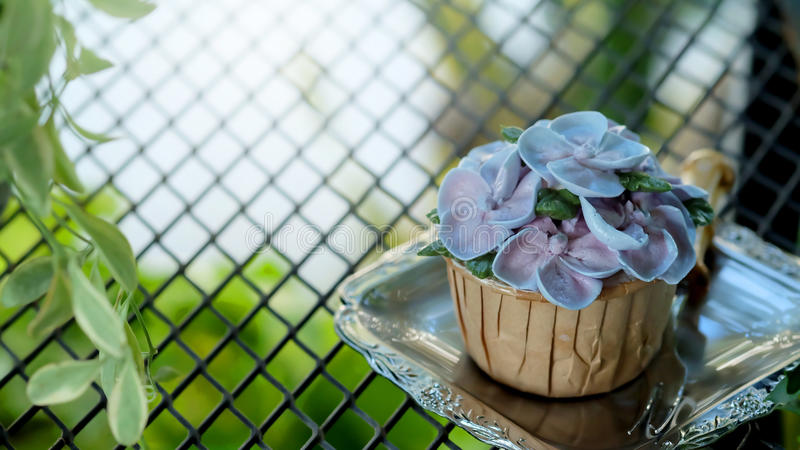 Blue cupcake design cream like blue Hydrangea flower on Steel grating tear background. And , have some space for write wording royalty free stock photo