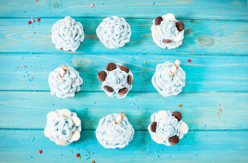 Blue cupcakes on wood vintage background. Top view royalty free stock photos