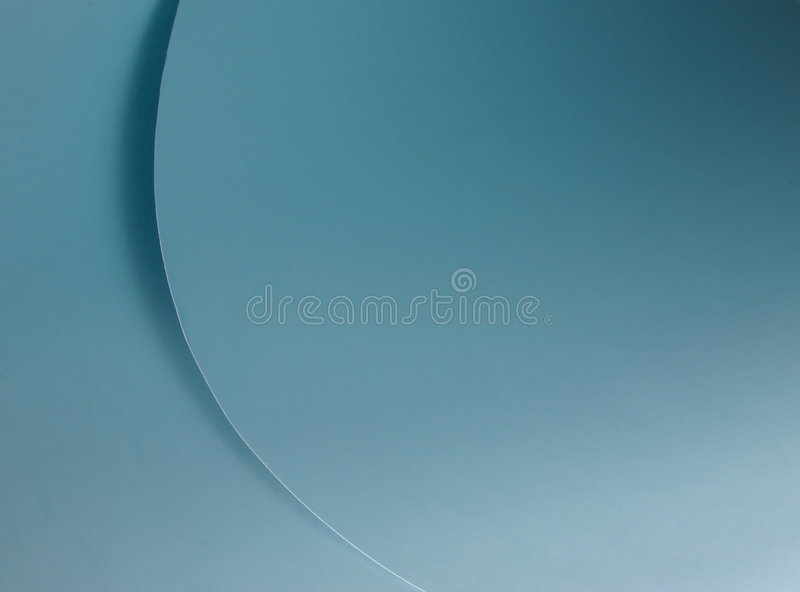 Blue curves. Shades and cirves created by a blue paper sheet