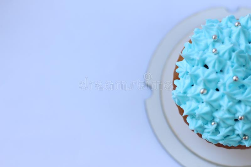 Blue custard cupcake, birthday concept royalty free stock photos