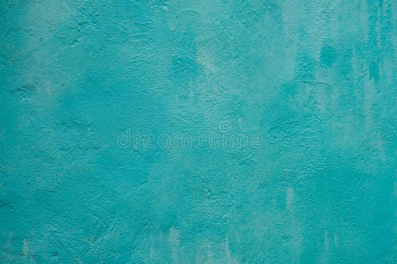 Blue Cyan Painted Stucco Wall Texture. Abstract Grunge Decorative Light Blue Plaster Wall Background. Wall Handmade Rough stock photo