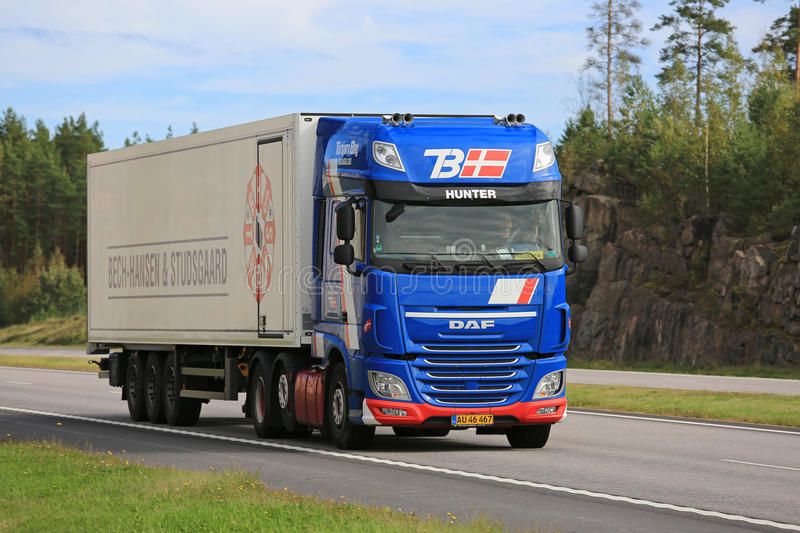 Blue DAF XF Hunter Semi Reefer Truck on the Road. PAIMIO, FINLAND - SEPTEMBER 9, 2016: New blue DAF XF reefer truck of Torbjorn Bay moves along freeway in South royalty free stock images