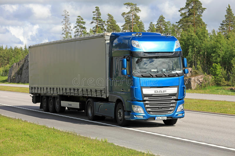 Blue DAF XF semi trailer road transport at summer stock images