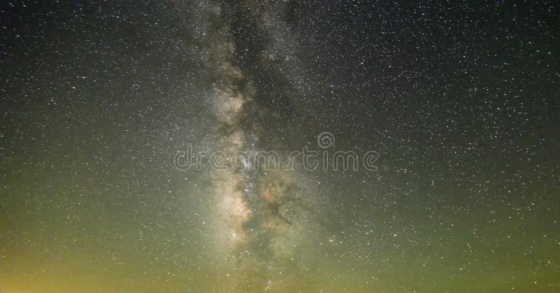 Blue dark night sky with many stars above field of trees. Yellowstone park. Milkyway cosmos background. Blue dark night sky with many stars above field of trees royalty free stock photography