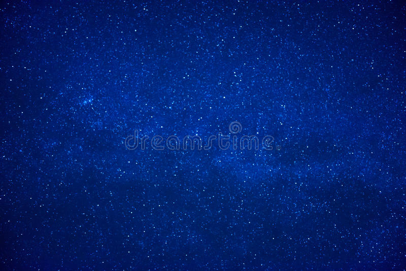 Blue dark night sky with many stars. Milky way on the space background stock photography